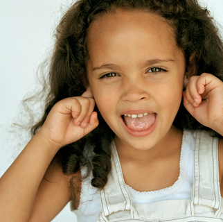 Child with her fingers in her ears.